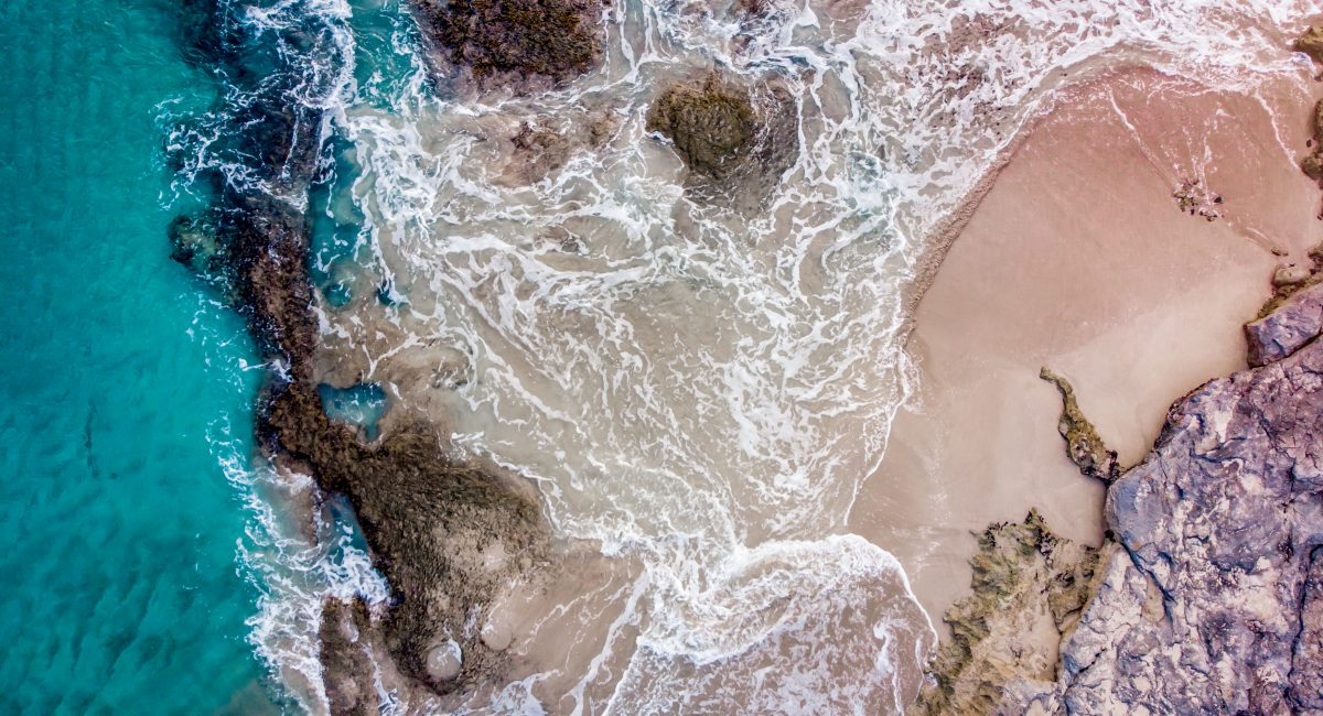 Drone imagery of O'ahu's southern coastline where researchers in the Molecular Ecology Lab at the University of Hawai'i use coral DNA from filtered seawater to assess coral cover on local reefs (Credit: Patrick K. Nichols).
