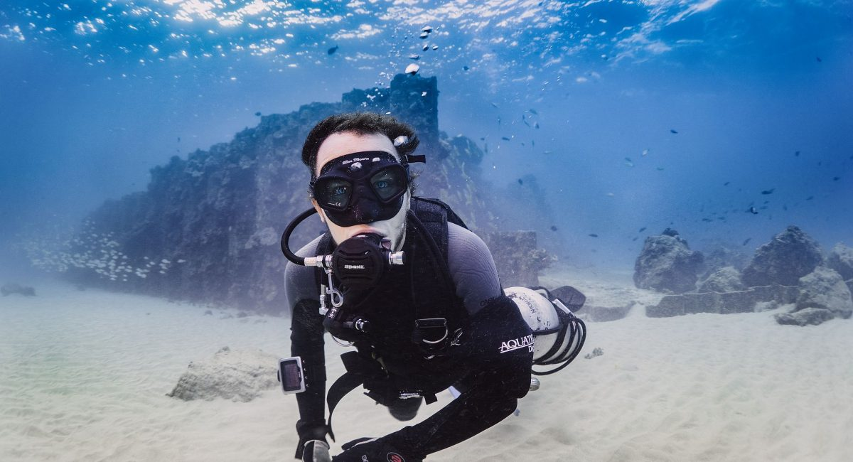 Patrick Nichols, a graduate student at the University of Hawaiʻi at Mānoa, tracks changes to coral reef communities. As a scientific research diver, his research aims to help conservation initiatives in Hawaiʻi and worldwide. (Credit: Patrick K. Nichols).